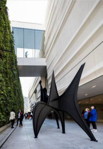 Pat and Bill Wilson Sculpture Terrace featuring Alexander Calder's sculpture Maquette for Trois Disques (Three Disks), formerly Man (1967) and the living wall, designed by Habitat Horticulture; photo: © Henrik Kam, courtesy SFMOMA